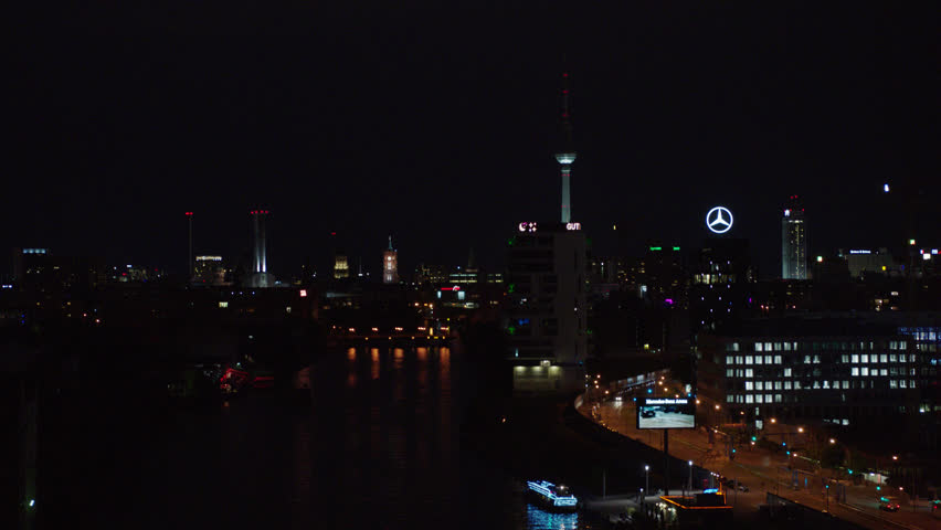 May, 2017 Berlin, Germany. Berlin skyline at night with TV Tower, Spree River, and street traffic from aerial view with push in.
