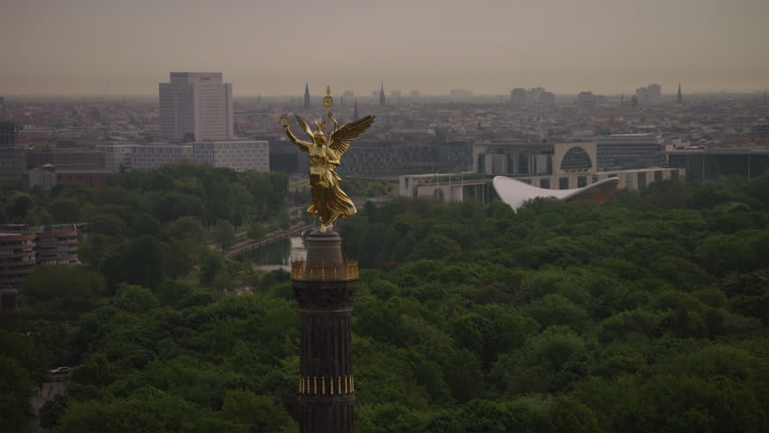 May, 2017 Berlin, Germany. A close up and zoom out of the Victory Column in the morning with Berlin city in the background.