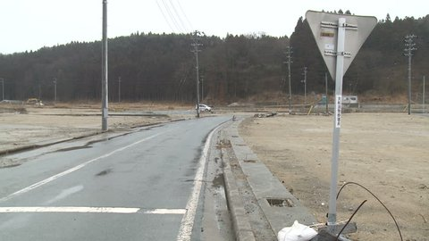 One year on, empty plots of land in town devastated by tsunami in Rikuzentakata, Japan.