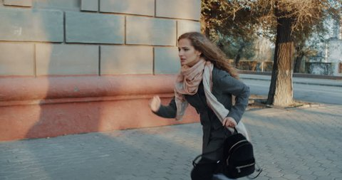 Young business woman in hurry running to a meeting