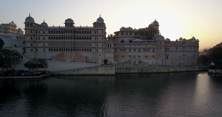 Aerial view of City Palace, Udaipur at sunrise lake Nichola 4K
