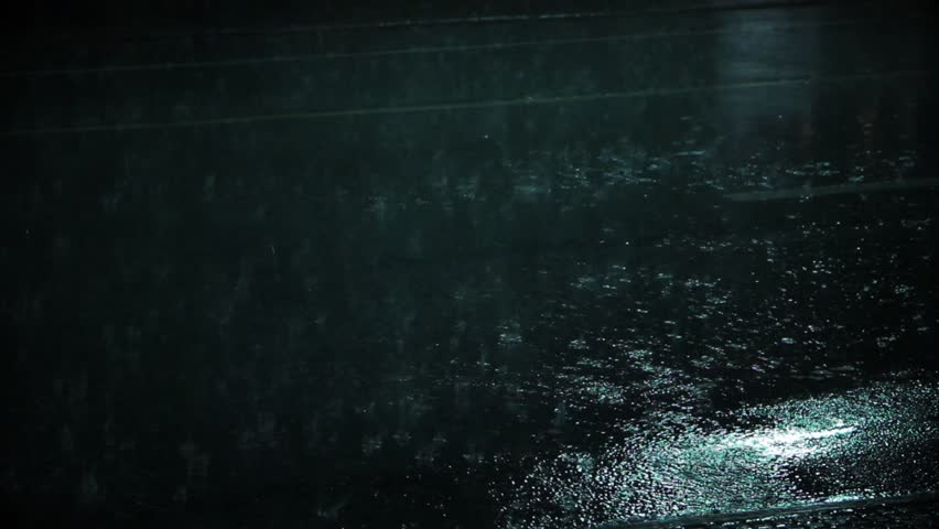 Heavy Rain On the Asphalt at Night.