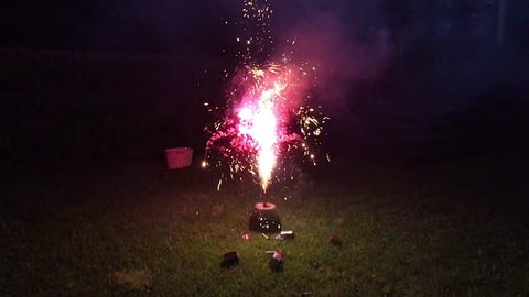 Launching fireworks explosive pyrotechnic in slow motion in home back yard.