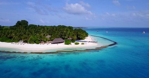v13668 maldives white sand beach tropical islands with drone aerial flying birds eye view with aqua blue sea water and sunny sky