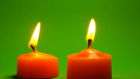 Two burning candle green screen clips.candle light green screen footage.Green screen clips of candle burning