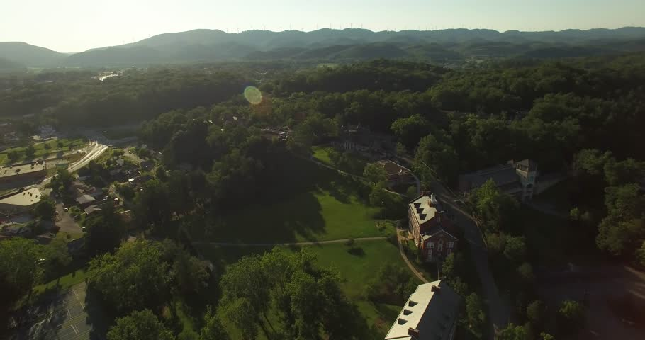 Aerial views of the Davis & Elkins College campus just before sunset on a beautiful summer evening with the mountains all around.