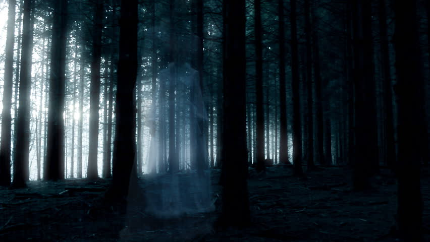 Horror or halloween movie scene: Ghost walking in the forest