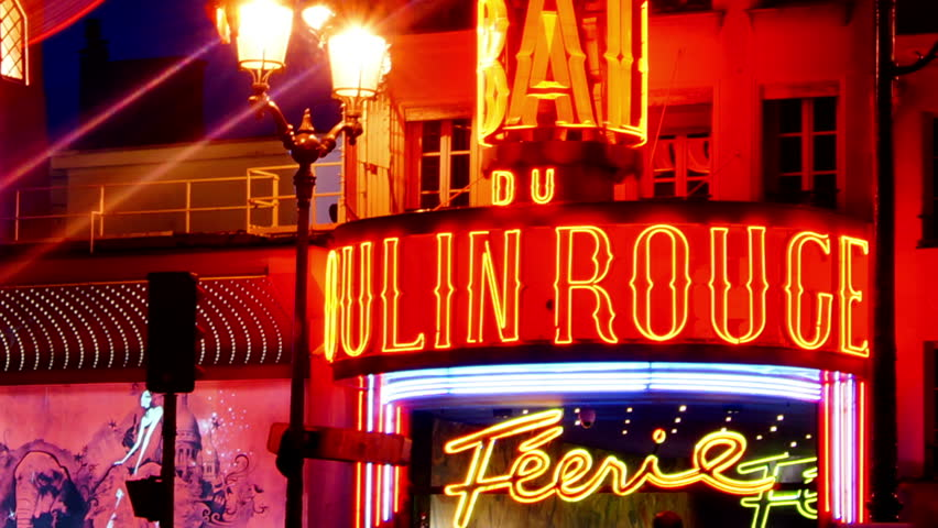 PARIS - SEPTEMBER 10: The Moulin Rouge by night, on September 10, 2012 in Paris, France. Moulin Rouge is a famous cabaret built in 1889, located in the Paris red-light district of Pigalle