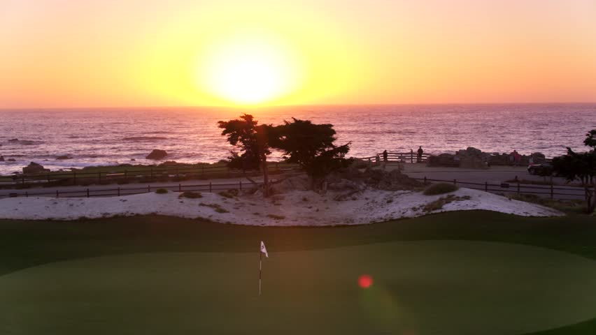 Aerial Drone Stock Video of Pebble Beach Golf Course at Sunset