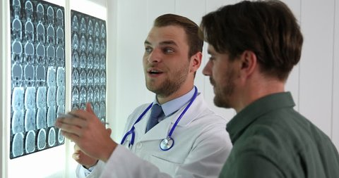 Doctor Man and Patient Discuss About Brain Mri Diagnostic Good News in Hospital