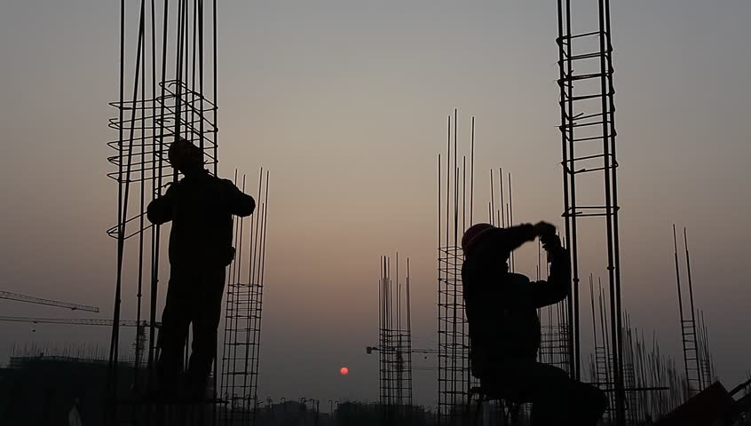 Worker working with concrete reinforce iron near sunset | Shutterstock HD Video #3259333