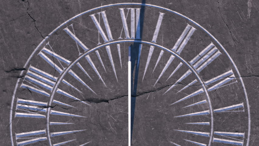 A macro closeup time-lapse of a camera panning across a vintage stone engraved sundial with time passing over a day