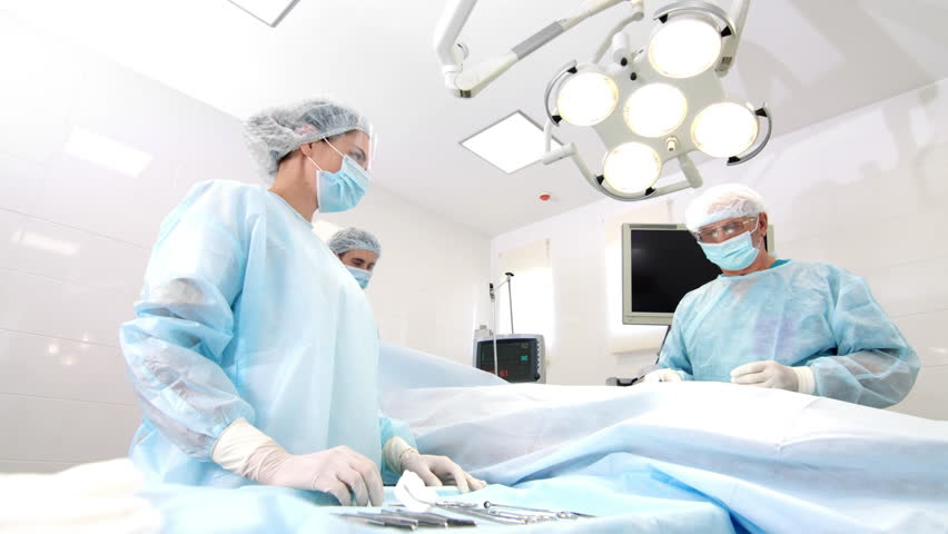 Three doctors performs surgical operation | Shutterstock HD Video #32637829