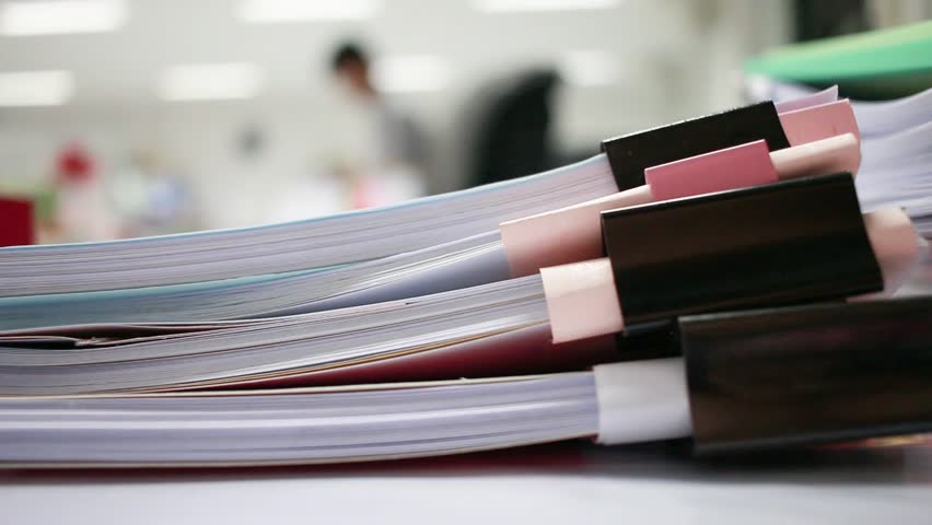 Paper stack, Pile of unfinished documents on office desk folders to business functions. Stack of business papers for Annual Report files, Document is written,drawn,presented. Business offices concept.