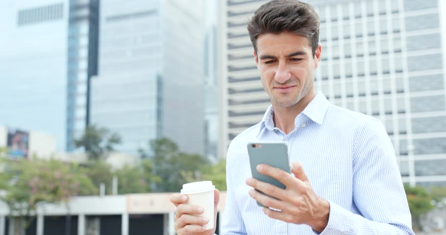 Man hold with mobile phone and drink of coffee | Shutterstock HD Video #32643103