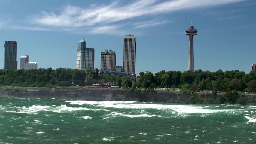 NIAGARA FALLS CITY - AUGUST 21: View of the Niagara Falls city through the Niagara River. August 21, 2012 in Niagara Falls city, Ontario, Canada.