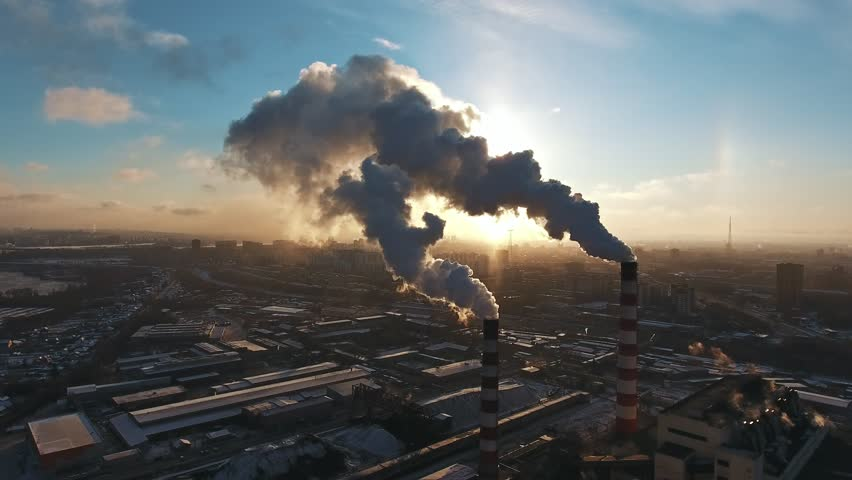 Industrial zone with a large red and white pipe thick white smoke is poured from the factory pipe in contrast to the sun. Pollution of the environment: a pipe with smoke. Aerial view | Shutterstock HD Video #32679253