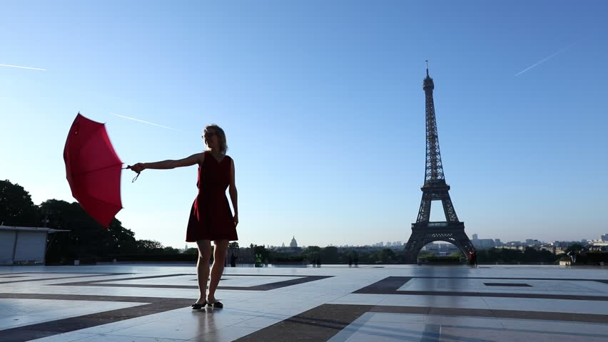 Travel to Paris, silhouette of beautiful girl dancing with red umbrella near Eiffel Tower | Shutterstock HD Video #32699506