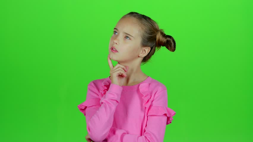 Baby thinks and she comes up with an idea. Green screen. Slow motion   Shutterstock HD Video #32709763