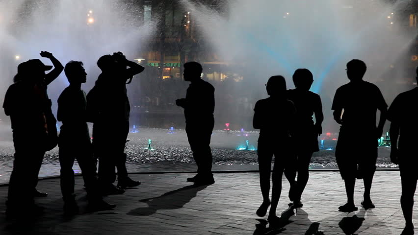 KUALA LUMPUR - OCTOBER 20:  people in front of illuminated colored fountains in front of  KLCC Suria mall on October 20, 2012 in Kuala Lumpur, Malaysia | Shutterstock HD Video #3271223