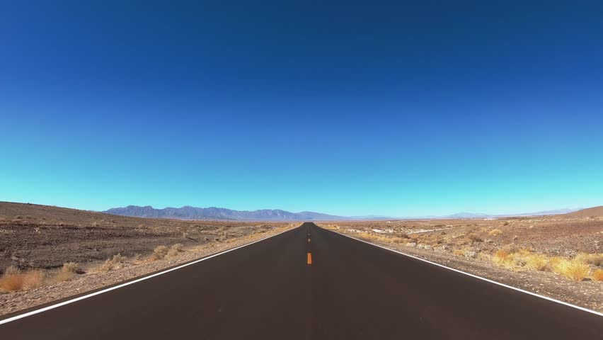 Driving through Death Valley National Park - endless streets in the desert