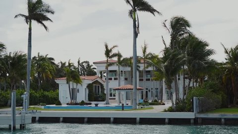 luxurious villa in white colours and own dock for yachts or boats on the shore,sunny isles beach,miami
