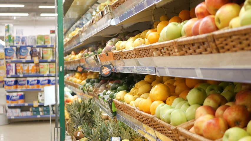 Woman choosing lemons at the grocery store picks up lemons at the fruit and vegetable aisle in a supermarket | Shutterstock HD Video #32724388