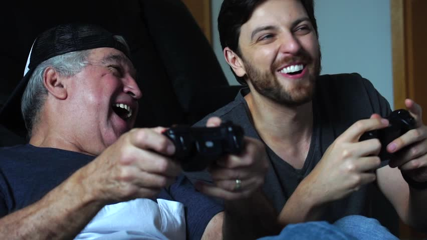 Father and Son Playing Videogame
