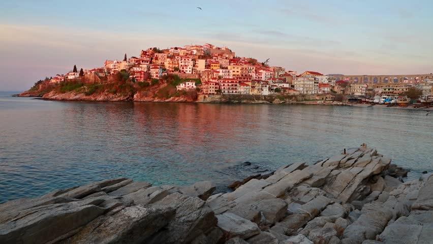 Splendid spring seascape on Aegean Sea. Colorful sunrise in Kavala city, the principal seaport of eastern Macedonia and the capital of Kavala regional unit. Full HD video (High Definition).