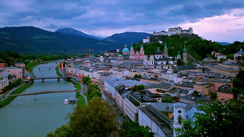 Time lapse clip. Colorful spring sunrise over old town of Salzburg, Austria, Europe. Full HD video (High Definition).