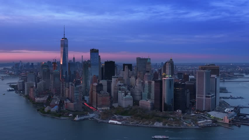 Aerial view of The Financial District in Lower Manhattan. Cityscape and famous skyscrapers of New York City. Shot from a helicopter. | Shutterstock HD Video #32798539