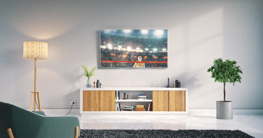 Footage of a living room led tv on white wall with wooden table and plant in pot showing rugby game moment on 3D rendered sports stadium.
