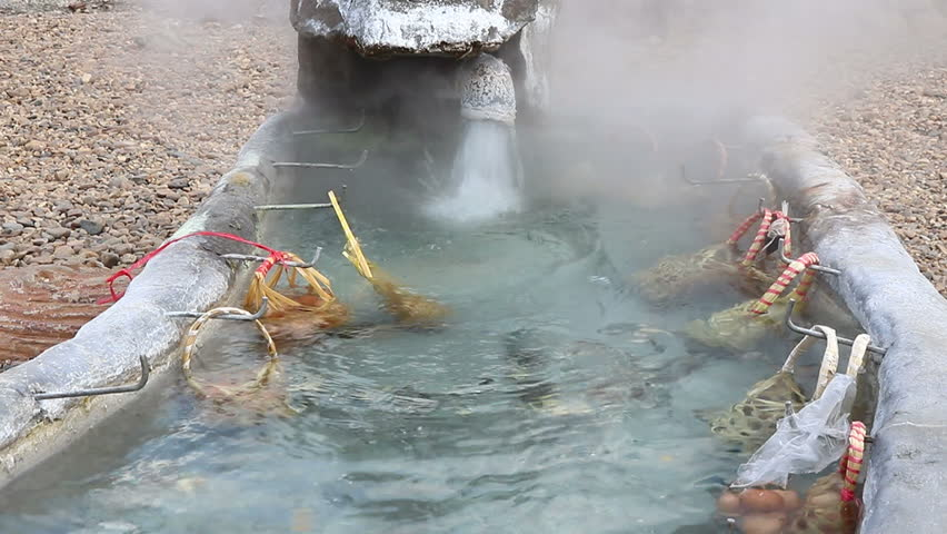 Eggs in the basket are boiled in hot springs at sankamphaeng hot springs chiangmai,Thailand   Shutterstock HD Video #32823454