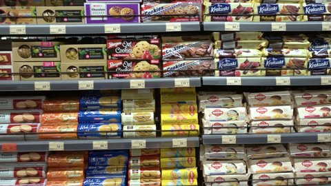 Many cookies and candies on the shelf in the supermarket. Kaliningrad - November 2017 Russian.