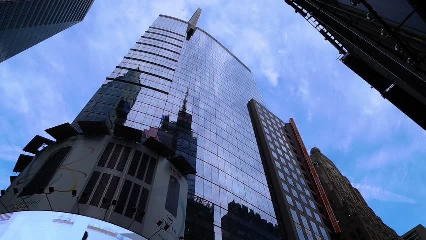 NEW YORK CITY - FEBRUARY 2016. skyscraper in NYC on the clouds backround - TIMELAPSE. | Shutterstock HD Video #32842957