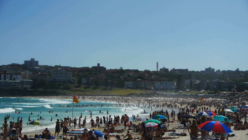 the view looking south on bondi beach on a busy summer day