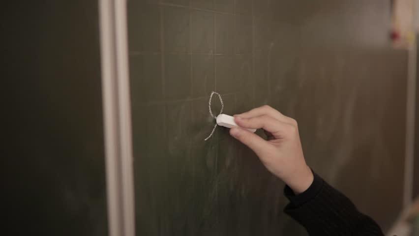 Schoolboy writes on a whiteboard | Shutterstock HD Video #32860711