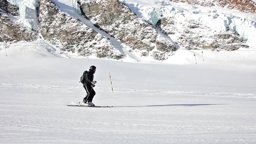 "Downhill skiing scene in ""Saas Fee"" Switzerland"