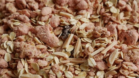Close up of Strawberry Granola Oat Cereal textured with Almond and Raisin for Healthy Breakfast and Snack.