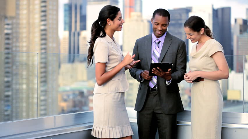 Multi ethnic female and male successful executive managers working on portfolio online touch screen on rooftop city office overlooking Manhattan | Shutterstock HD Video #3289223