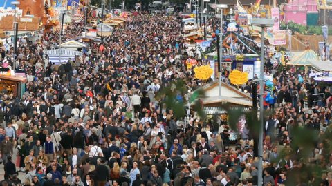 September 17, 2017 - Oktoberfest, Munich, Germany: A view of the huge crowd of people walking around the Oktoberfest in national bavarian suits, on Theresienwiese, top view