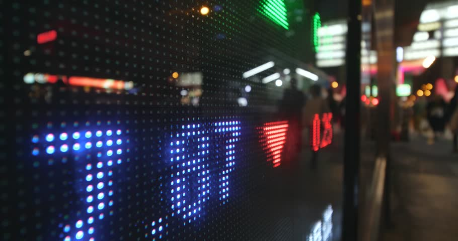 Stock market trading graph in city at night | Shutterstock HD Video #32920672