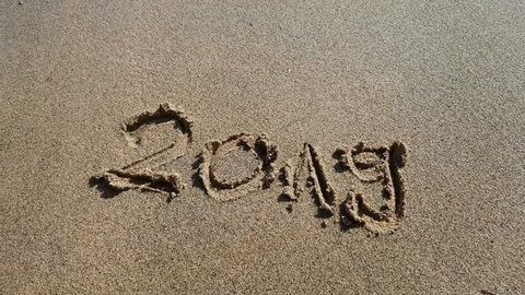 sign in beach sand saying 2019 denoting a new year 2019