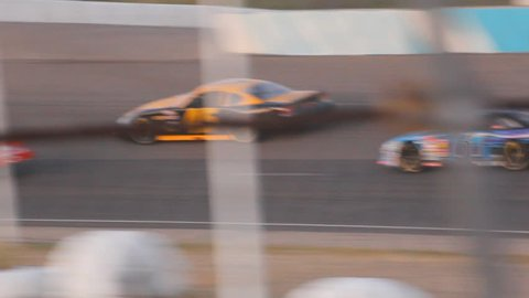 Tucson, AZ - October, 2010: Nascar style race cars playing it tight into the turn