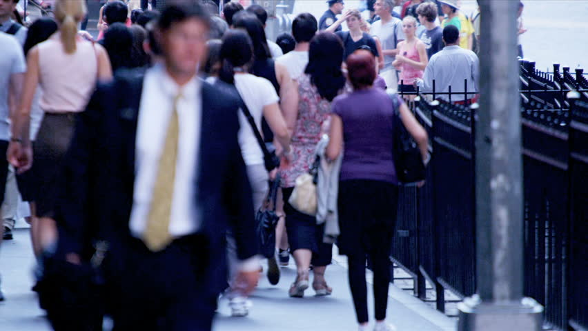 New York - August 21, 2012: Business commuters on busy city sidewalk on Wall Street