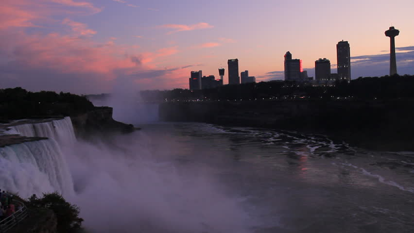 Niagara Falls Twilight Skyline. Minutes after sunset on a beautiful summer day in Niagara Falls. No color correction or editing has been done on this clip.