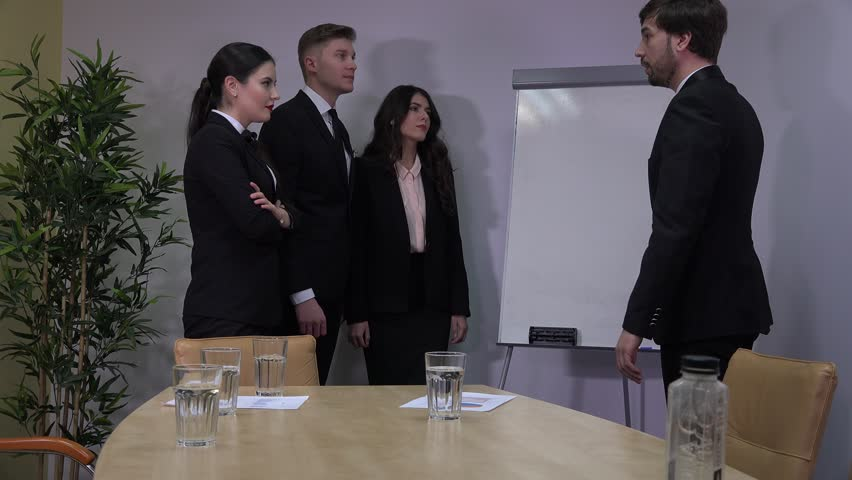 Standing business team teamwork young people men women discussing boardroom meet | Shutterstock HD Video #32978587