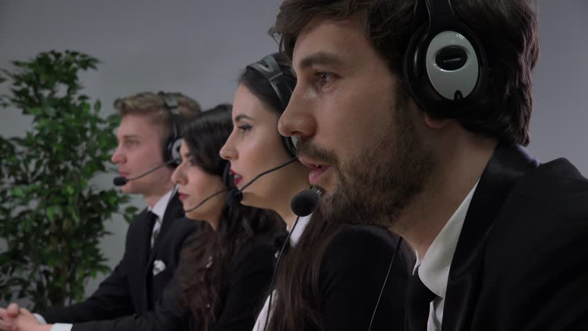 Call center consultants team working headphones discussion corporate workers job | Shutterstock HD Video #32978620