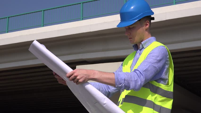 Architect man checking blueprints planning outdoors at site builder portrait smile cheerful joyful young engineer architect workman check blueprint 4k stock footage clip malvernweather Choice Image