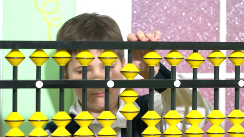 School boy dressed up as teacher holding abacus in a classroom. | Shutterstock HD Video #33009937